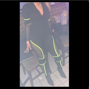Black and neon green body suit